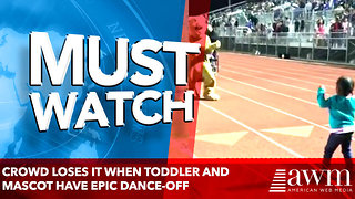 CROWD LOSES IT WHEN TODDLER AND MASCOT HAVE EPIC DANCE-OFF - Video