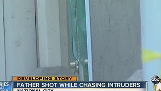 Father shot while chasing intruders - Video