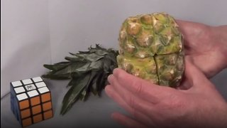 Man creates Rubik's cube out of pineapple, then solves & eats it