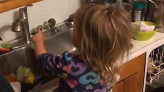 Turns Out This Little Girl REALLY Likes Doing The Dishes