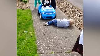 Little Boy Pretends To Be Hit By a Toy Car - Video