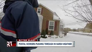 Postal workers battle cold to deliver mail - Video
