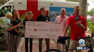 Day 3 of Steve Weagle Ride for the Red Cross: Receiving donation from Volo Foundation