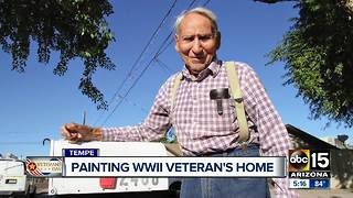 Valley group comes together to paint a veteran's house - Video