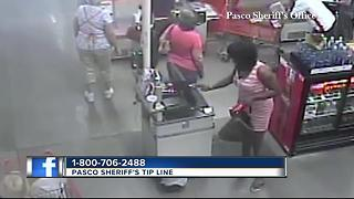 Surveillance video shows crooks dressed in drag push clerk, steal gift cards - Video