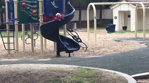 Girl doesn't want to leave park, goes painfully slow down slide