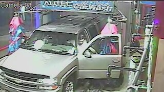 Man Opens Car Door While In Automatic Car Wash To Fix Wipers, But Brush Returns And Slams Door In Opposite Direction
