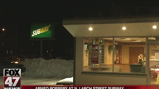 Police investigate armed robbery at Lansing Subway location - Video