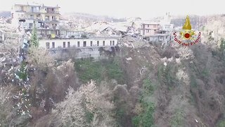 Drone Video Shows Bulldozers at Work in Aftermath of Central Italy Quake - Video
