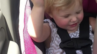 Gorgeous Little Girl Is Enjoying Her Favorite Song While Singing And Dancing