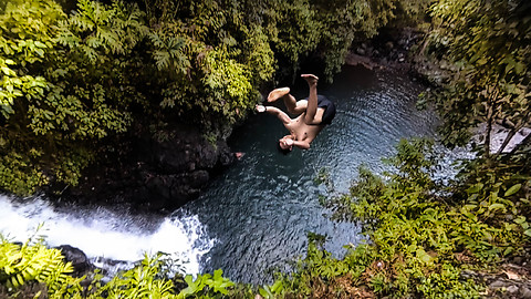 Insane waterfall cliff diving in Bali