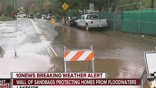 As rain falls, Lakeside homes brace for flooding - Video