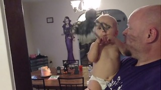 Baby spooked by Halloween spider - Video