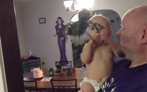 Baby spooked by Halloween spider