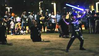 Crowd Cheer for Father and Son's Impressive Lightsaber Duel - Video