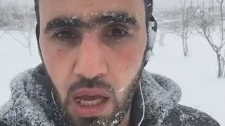 Snow-Covered Syrian Activist Asks World to Be 'Guardian Angels' to Aleppo Refugees - Video