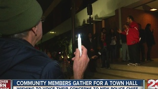 Community members gather for a town hall - Video