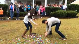 Expecting Couple Was Surprised To See Rainbow Confetti After Popping Gender Reveal Balloon - Video