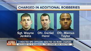 3 previously indicted police officers face additional robbery charges - Video