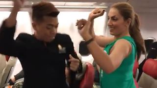 Cabin crew and passengers dance in airplane - Video