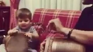 Father and son perform music - Video