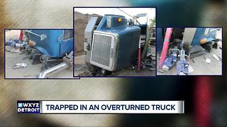 Rescue crews talk about freeing driver from overturned gravel hauler - Video