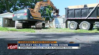 Pasco home demolished to fix flooding problems - Video