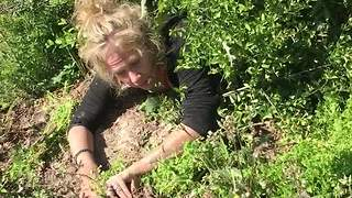 Woman on drugs searches for drive shaft in the bushes - Video
