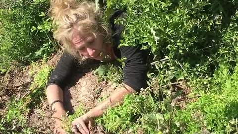 Woman on drugs searches for drive shaft in the bushes