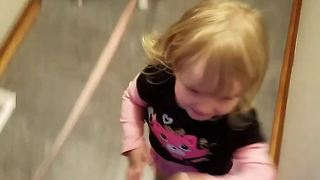 Excited toddler affectionately hugs everyone - Video