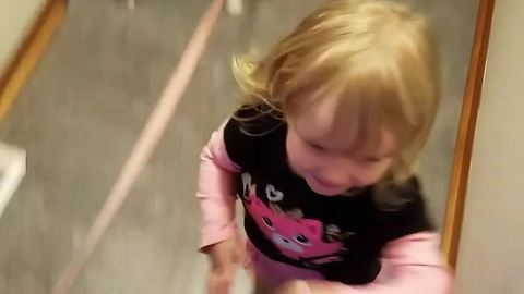 Excited toddler affectionately hugs everyone