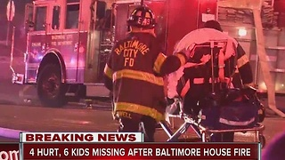 4 injured, 6 children unaccounted for in Baltimore house fire - Video