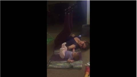 Baby works out with mom, mimics her moves