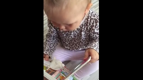"Baby adorably startled by harmless ""lamb"" book"