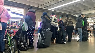 Organization brings Christmas to families in need - Video