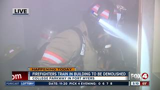 Firefighters training in building set for demolition - 8am live report - Video