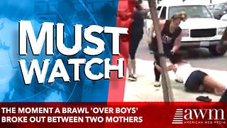 The moment a brawl 'over boys' broke out between two MOTHERS