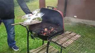 Man Uses Drone to Help Start BBQ - Video