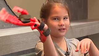 Henderson girl with birth defect living out baseball dreams thanks to technology - Video