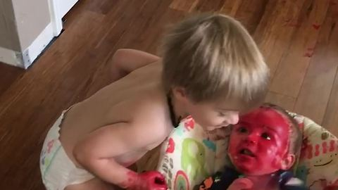 Brother Covers Self And Baby Brother In Red Paint Or Makeup