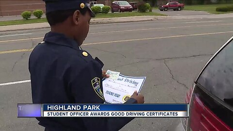 Student officer awards good driving certificates in Highland Park