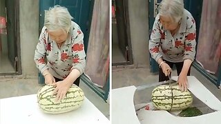 YOU'RE TWISTING MY MELON NAN: GRANDMA SMASHES TABLE WHILE CUTTING INTO GIANT WATERMELON