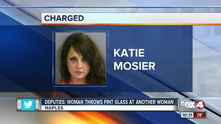 Woman throws pint glass at another woman - Video