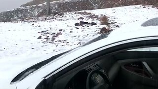 Snow Falls on Mountain Top in Saudi Arabia - Video