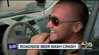 Truck hauling beer tips over on Valley freeway - Video