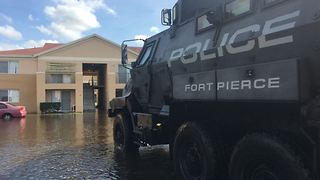 Fort Pierce police use MRAPS to help people in flooded areas - Video