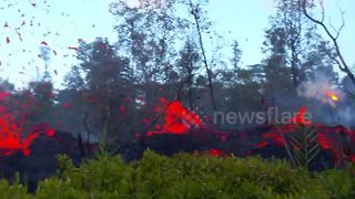Lava and steam spew from side of cracked road in Hawaii - Video