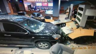 Terrifying moment driver ploughs car into internet cafe