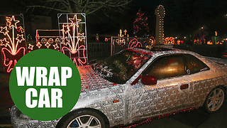 A Christmas fanatic has dressed his car up in wrapping paper - Video