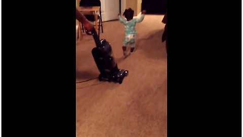 Baby girl runs to escape evil vacuum cleaner